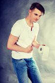 Young man with stomach issues. poster