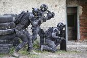 Spec ops police officers SWAT in black uniform in action poster
