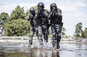 Spec ops police officers SWAT in action in the water poster