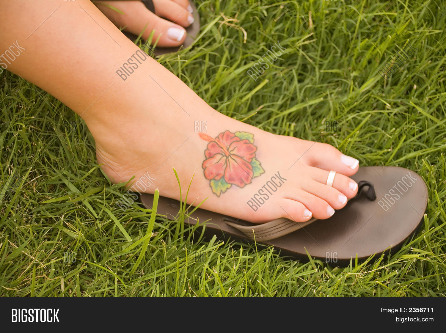 Womans foot on sandal image photo free trial bigstock womans foot on a sandal with a hawaiian hibiscus flower tattoo izmirmasajfo