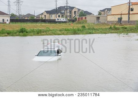Sedan car swamped by flood water in East Houston, Texas, US by Harvey Tropical Storm. Submerged car