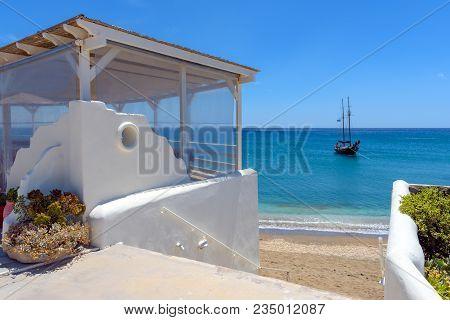 Tavern Terrace Overlooking The Aegean Sea, Paleochori Beach, Milos. Cyclades Island, Greece.