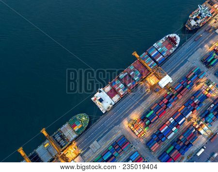 Aerial View Of Business Port With Shore Crane Loading Container In Container Ship In Import/export A
