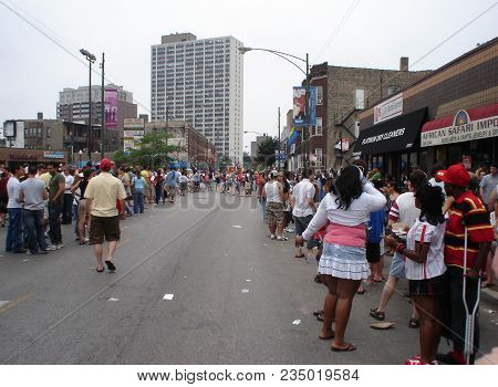 Spectators Casually Gathering Along The Side Of The Street During The Chicago Gay Pride Parade, Chic