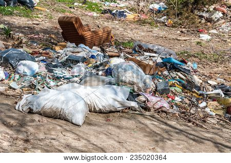 Garbage. Big Pile Of Junk And Garbage Dumped In The Nature Or Park In The City Polluting The Environ
