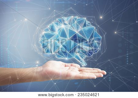 Hand Holding Digital Polygonal Brain On Blue Background. Artificial Intelligence And Innovation Conc