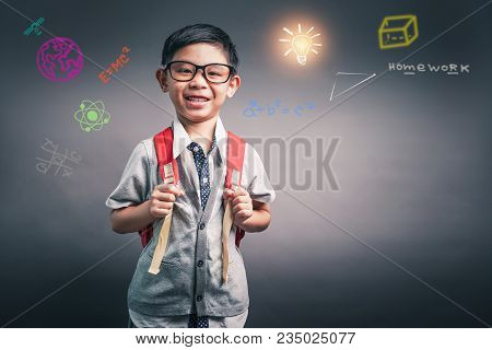 Cheerful Smiling Little Boy With Big Backpack. Looking At Camera. School Concept. Back To School