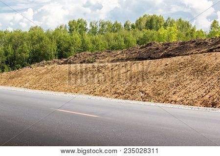 Old Asphalt Road With Dividing Line In Summer Day