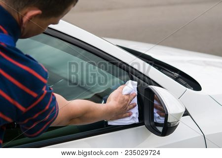 The Man Is Wiping The Car Glass, Close-up