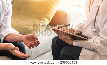 Doctor Or Psychiatrist Consulting And Diagnostic Examining Stressful Woman Patient On Obstetric - Gy