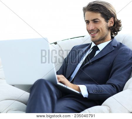 close-up of smiling businesswoman working with laptop in living room.