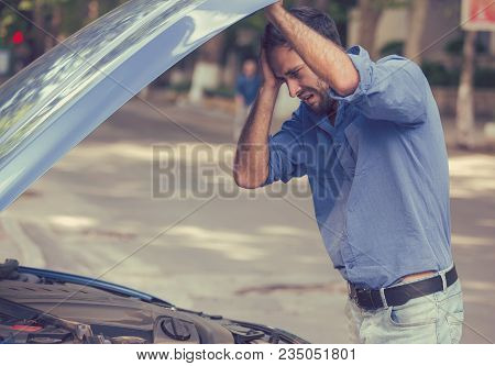Young Stressed Man Driver Having Trouble With His Broken Car Looking In Frustration At Failed Engine