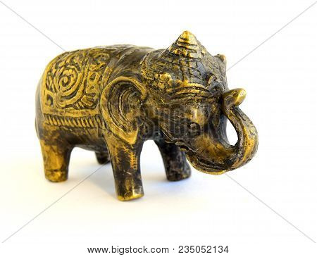 The Sculpture Of An Elephant Is Made Of Old Bronze. The Sculpture Is Located On A White Background