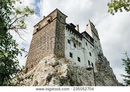 Bran Or Dracula Castle In Transylvania, Romania. The Castle Is Located On Top Of A Mountain Under A