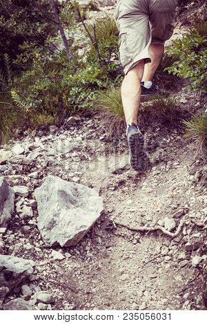 Background Hike Into The Mountains, Symbol Of Mountain Runners, Runner Concept, Hiker Climbs Uphill