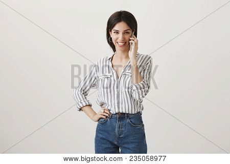 Happy To Hear Your Voice. Upbeat Excited Attractive Female In Stylish Striped Blouse Talking On Smar