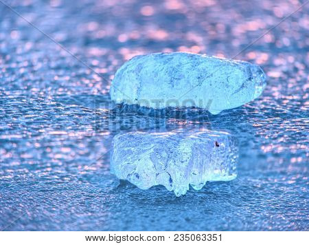 Natural Winter Icy Background Of Defocused Ice With Copy Space. Blue Purple Colors Of Ie Floes
