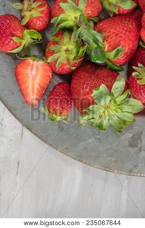 Plate Full Of Fresh Strawberries On Cement Background. Raw Strawberries. Fresh Strawberries. Top Vie