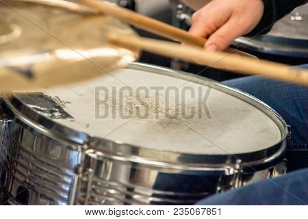 Drummer Playing On Drum Set Top View. Live Music Concert, Band During Performance. View And Look Thr