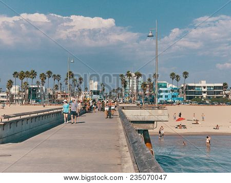 Venice Beach, California, Usa - September 1, 2017. People Walk On The Pier And Sunbathe On The Beach