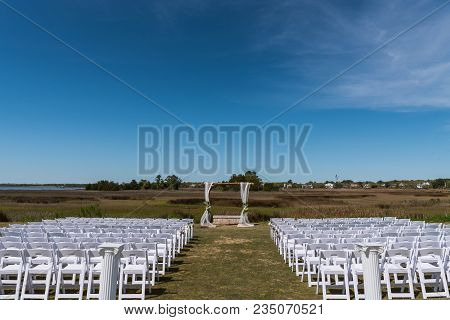 Blue Sky Above Wedding Setup In Southern Marsh Setting