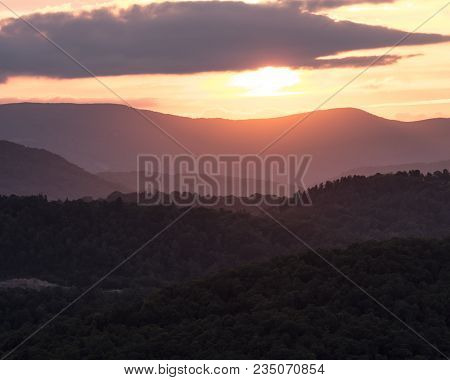 Sun Begins To Set Below Blue Ridge Mountain Ridges