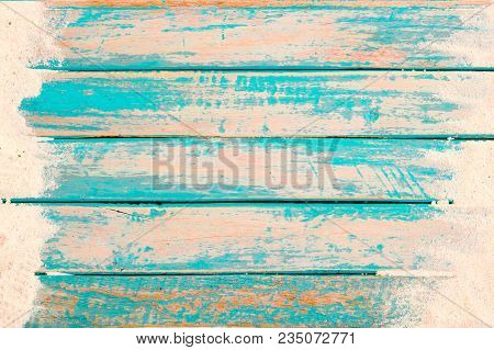 Beach Background - Top View Of Beach Sand On Old Wood Plank In Blue Sea Paint Background. Summer Vac