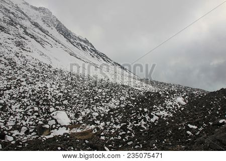 Fogy Spring Day. Snow Covered Rocks On The Way Down From Tserko Ri, Mountain In The Langtang Nationa