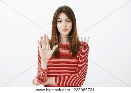 Girl Stops Friend From Drinking Alcohol. Studio Shot Of Displeased Annoyed Attractive Caucasian Woma