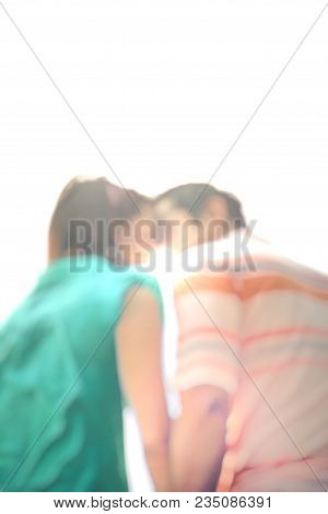 Blurry Of Couple Love Young People Kiss In The Sunset Spring In Sunlight.happy Couple Holding Hands