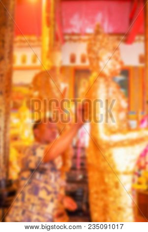 Thai Buddhist Put Golden Leave On Beautiful Golden Buddha Statue In Position Standing Inside Buddhis