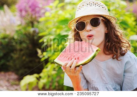 Summer Happy Child Girl Eating Watermelon Outdoor On Vacation, Wearing Sunglasses And Hat
