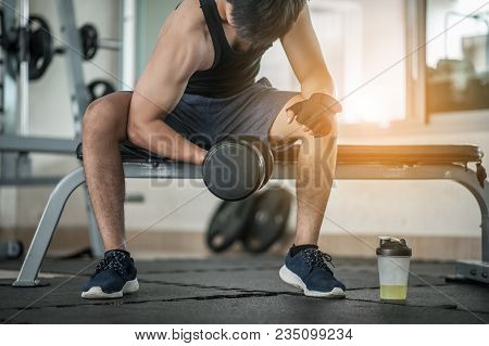 Bodybuilder Working Out With Dumbbell Weights At The Gym.handsome Power Athletic Man Bodybuilder Doi