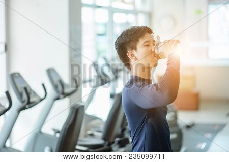 Muscular Man Drinking Protein Shake At Gym.sport, Fitness, Healthy Lifestyle And People Concept - Cl