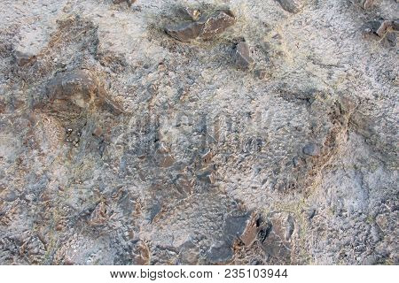 Surface Of The Sulfur Of The Hydrogen Volcano On The Island Of Vulcano, Italy. Gray And Yellow Backg