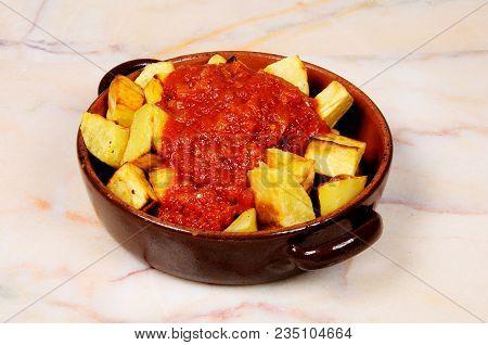 Spanish Tapas Of Patatas Bravas (chipped Potatoes In Spicy Tomato Sauce), Malaga Province, Andalucia