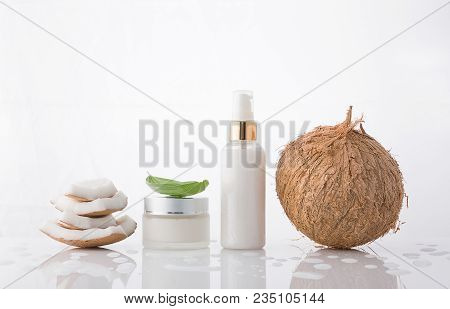 High Key Homemade Cosmetic Coconut Products With Coconut On White Background. Lotion Cream With Coco