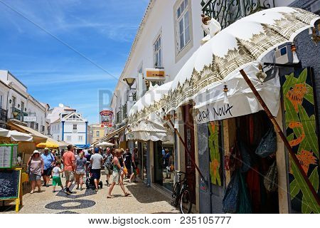 Lagos, Portugal - June 9, 2017 - Tourists Walking Along The R 25 De Abril Shopping Street In The Old