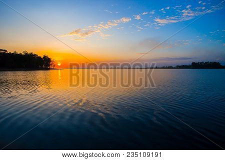 Sunset Sky Background. Dramatic Gold Sunset Sky With Evening Sky Clouds Over The Sea. Stunning Sky C