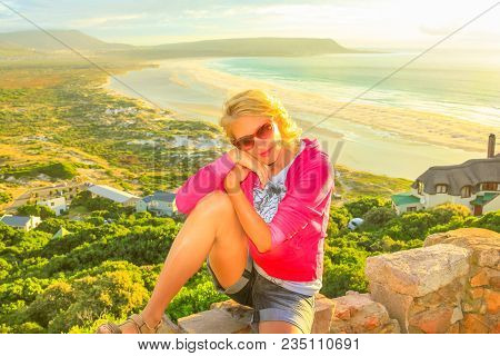 South Africa Summer Holidays Concept. Blonde Caucasian Young Woman Enjoying Aerial Views Of Noordhoe