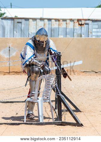 Goren, Israel, April 06, 2018 : Knight - A Participant In The Knight Festival, Resting In The Corner