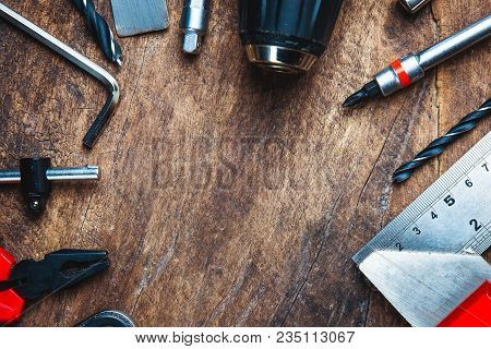 Set Of Construction Tools On Wooden Board As Wrench, Hammer, Pliers, Socket Wrench, Spanner, Tape Me