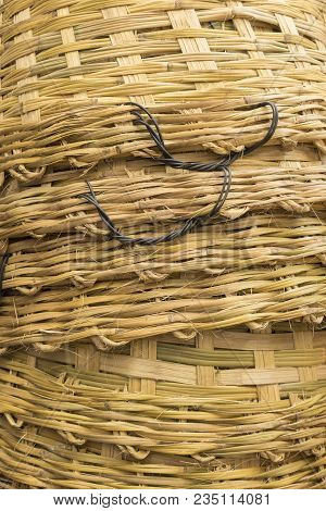 Background Of Stack Of Big Bamboo Basket Weave Surface