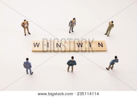 Miniature Figures Businessman : Meeting On Win Win Word By Wooden Block Word On White Paper Backgrou