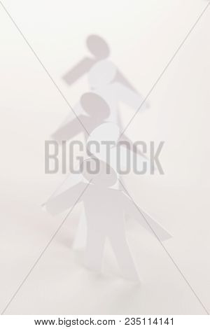 Linked Line Of Five  Paper Figure In Hand Up Posture On Bright White Background. In Concept Of Busin