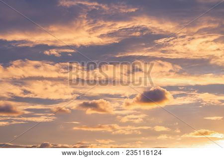 Sunset Sky Background. Dramatic Sunset Sky With Evening Sky Clouds Lit By Bright Sunlight - Natural