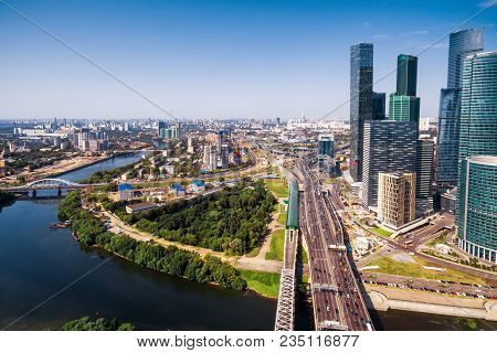 Aerial panoramic view of Moscow with Moskva River, Russia. Moscow skyline. Skyscrapers of Moscow-City in the right. Sunny panorama of Moscow. TTK road with a bridge. Scenery of Moscow in summer. poster