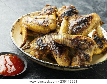 Close Up Of A Plate Of Barbecue Chicken Wing