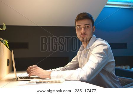 Picture Of Handsome Serious Male Employee In Formal Shirt Working On Financial Report, Sitting At Of
