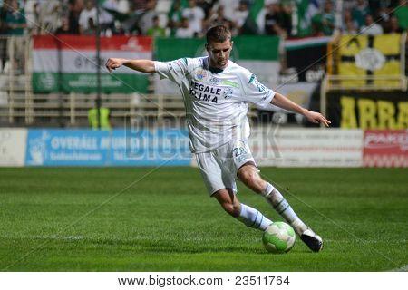 KAPOSVAR, HUNGARY - SEPTEMBER 10: Gabor Janvari in action at a Hungarian National Championship soccer game - Kaposvar (white) vs Gyor (green) on September 10, 2011 in Kaposvar, Hungary.